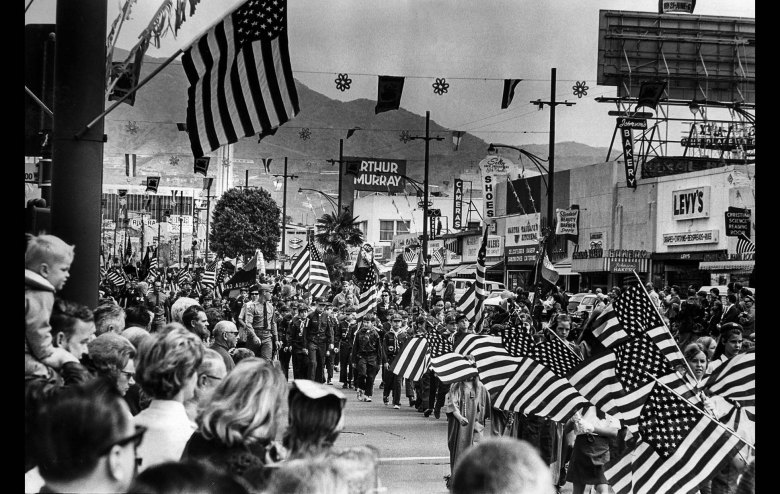 May 31, 1971: Girl Scouts, right, and Cub Scouts, center, march on Brand Blvd., during Memorial Day Parade in Glendale watched by 20,000 persons. This photo was published in the June 1, 1971 Los Angeles Times.